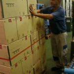 Paletizado manual cajas botellas 1